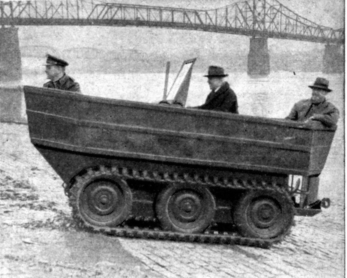 The Crosley Duck climbing out of the Ohio River at Cincinnati's Public Landing. Left to right: Unidentified U.S. Army captain, Duck engineer Paul Klotsch, and Powel Crosley, Jr.