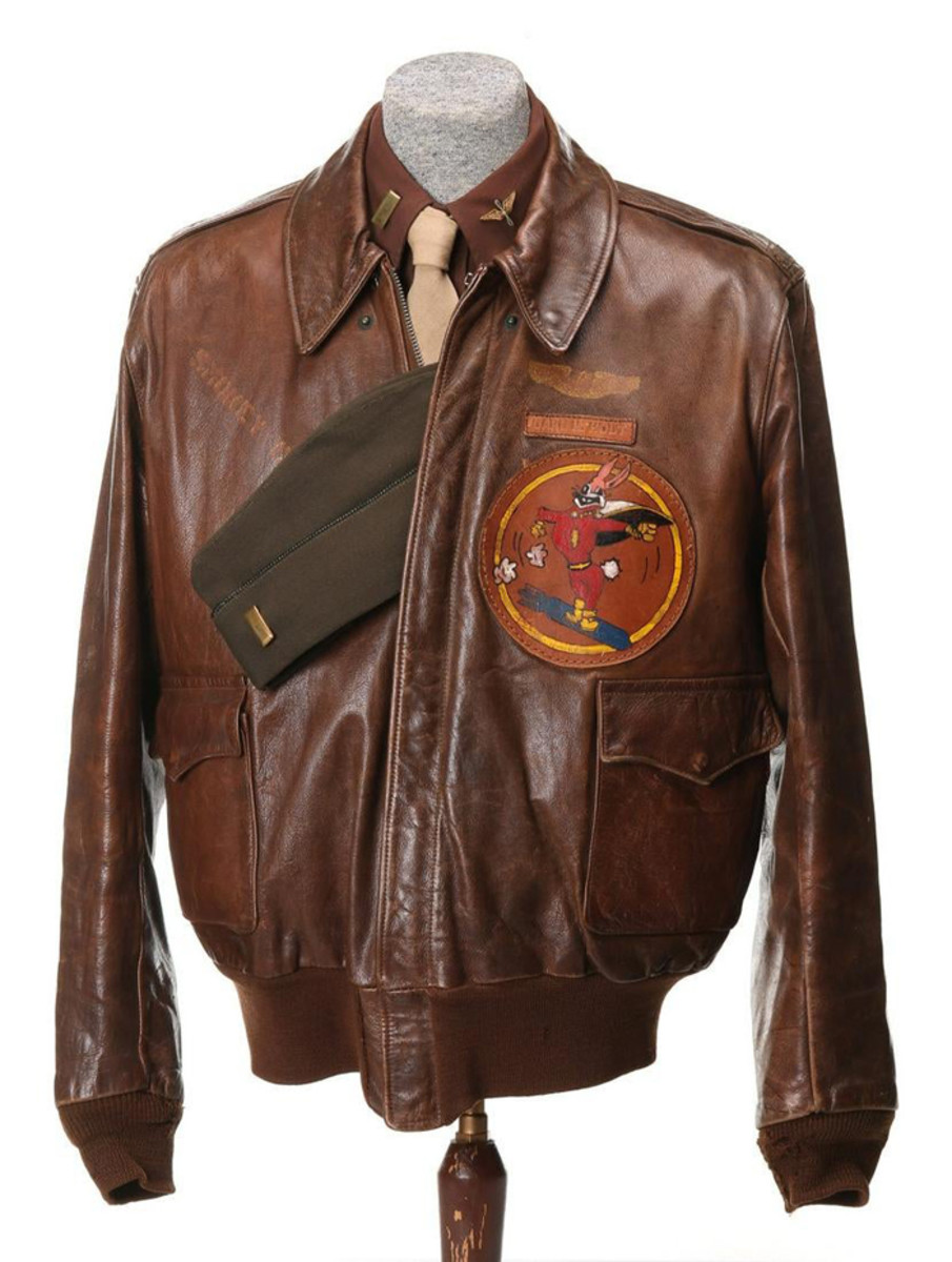 WWII-era A-2 bomber jacket with painted leather insignia, named for 2nd Lt. Carl H. Holt, USAAF 448th Bombardment Squadron, 8th AAF European Theatre.
