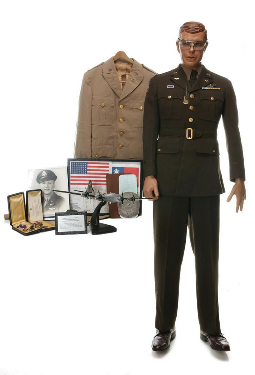 Wartime archive of Captain Walter R. Ross, USAAF, Fifth Bombardment Squadrom, Ninth Bombardment Group, 5th USAAF, a bombardier and Japanese POW who witnessed bombing of Hiroshima. Uniform, medals, documents, photos including crew of the 'Enola Gay' signed by the Hiroshima mission's commander and pilot Colonel Paul W. Tibbets Jr.