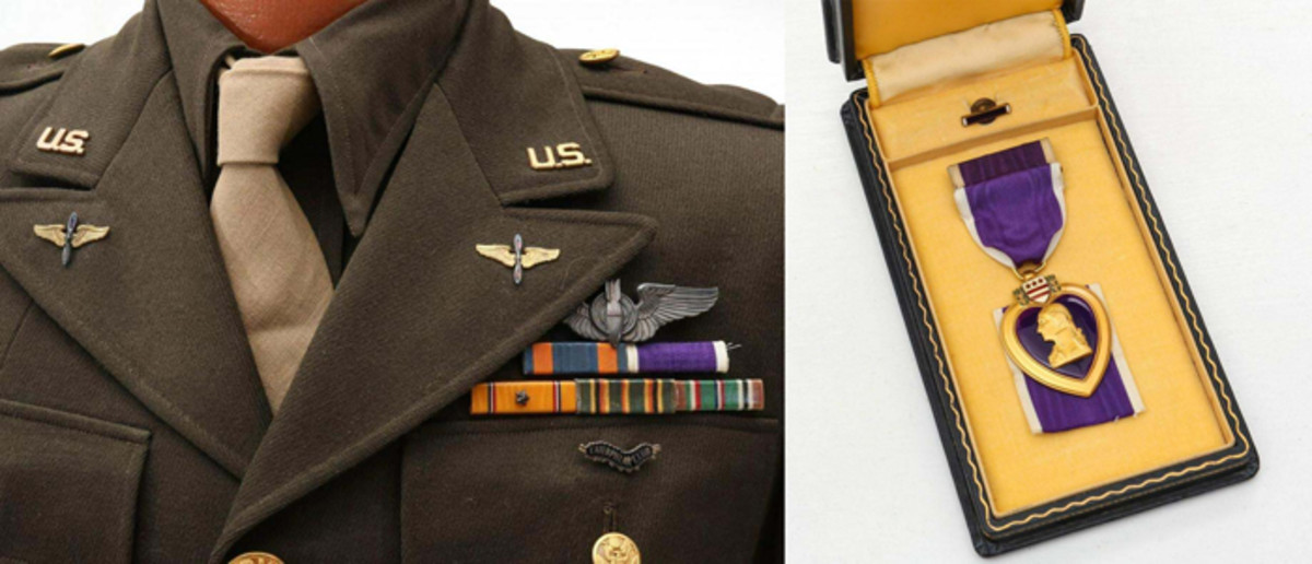 Closeup showing (at left) 1st Lt. Joseph E. Wemheuer's 'Caterpillar Club' insignia pinned to his jacket lapel pocket, and (right) his Purple Heart medal.