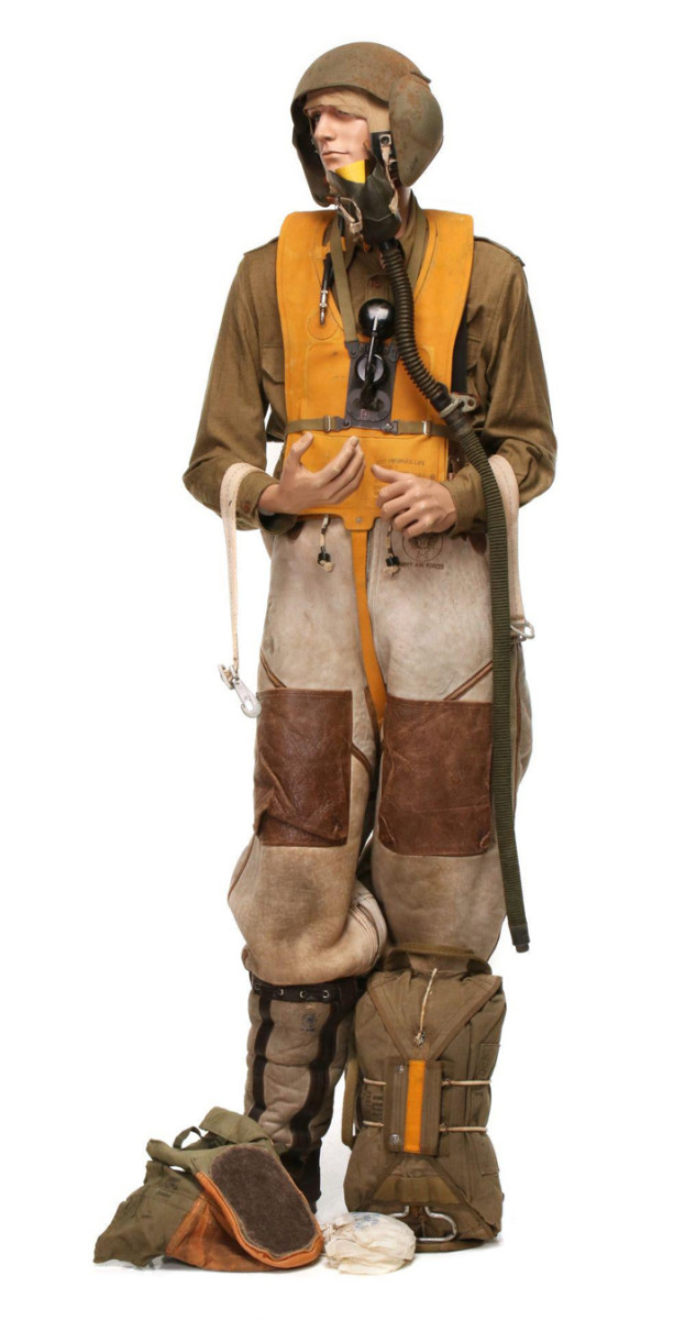 8AAF B-17 bomber crew member grouping consisting of arctic flight boots, arctic flight trouser, OG shirt, life vest, speaker assembly, oxygen mask, flight helmet, arctic mittens, more.