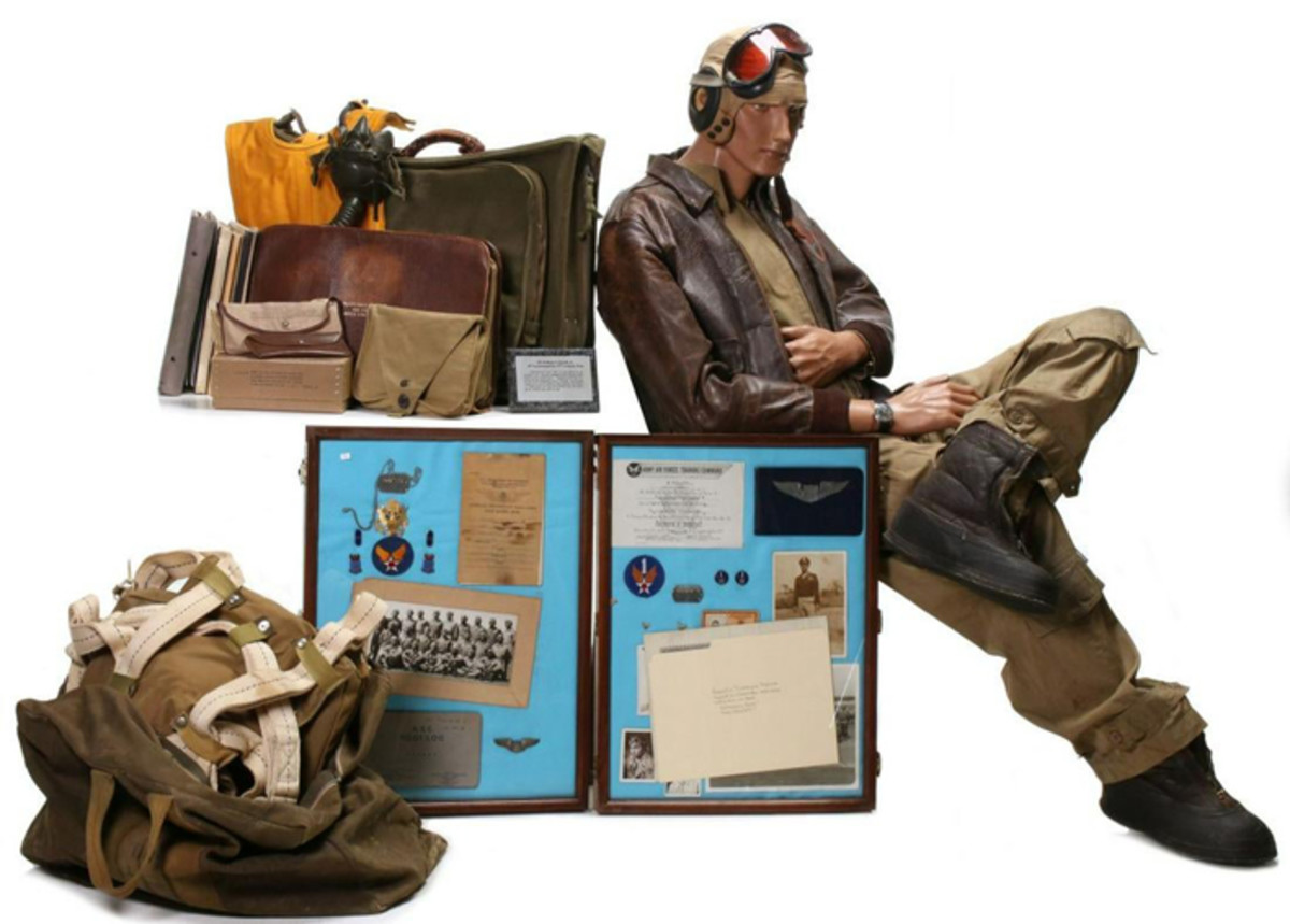 Important 75-piece archive of personal and service items belonging to Tuskegee Airman William S. Powell Jr. Uniform includes A-2 leather jacket with squadron patch and name, flight suit and other apparel with all insignia, parachute, kit bag, flight log, many documents including Tuskegee diploma with signatures of classmates and instructors.