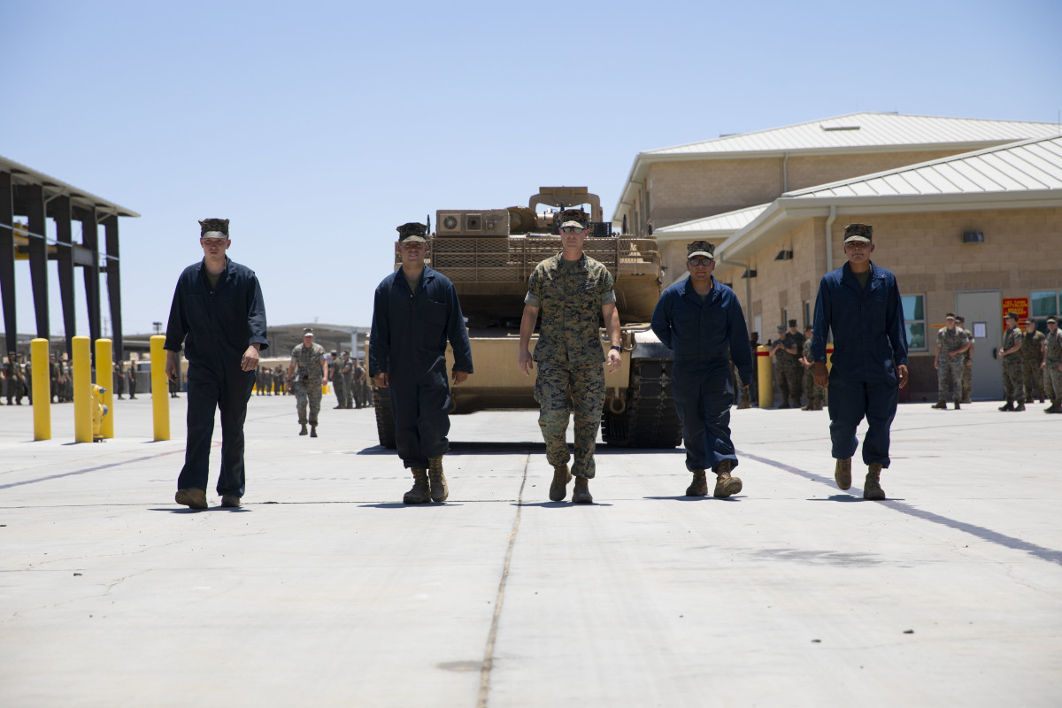 Lt. Col. Benjamin Adams, commanding officer of 1st Tank Battalion, and Marines with 1st Tank Battalion ground guide the last tank in 1st Tank Battalion at Marine Corps Air Ground Combat Center Twentynine Palms, California, July 6, 2020.