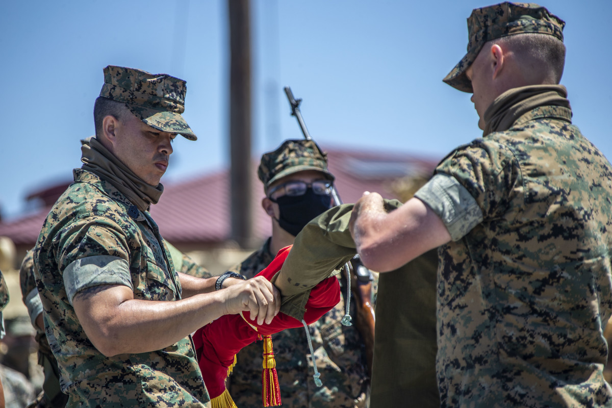 U.S. Marine 1st Sgt. Adam Casas, left, the company first sergeant of Alpha Company, 4th Tank Battalion, 4th Marine Division, Marine Force Reserve, and Capt. Mark Rothrock, the company commander of Alpha Co., 4th Tank Bn., 4th MarDiv, MARFORRES, case the company's colors during the company's deactivation ceremony in 41 Area on Marine Corps Base Camp Pendleton, California, July 18, 2020. Alpha Co., along with the rest of 4th Tank Bn., was activated in 1943 during World War II. Since then, the battalion has participated in every war the Marine Corps has fought in. Alpha Co. is the first of 4th Tanks' six companies to deactivate. The Marine Corps is divesting its tank battalions following the commandant's guidance in Force Design 2030.
