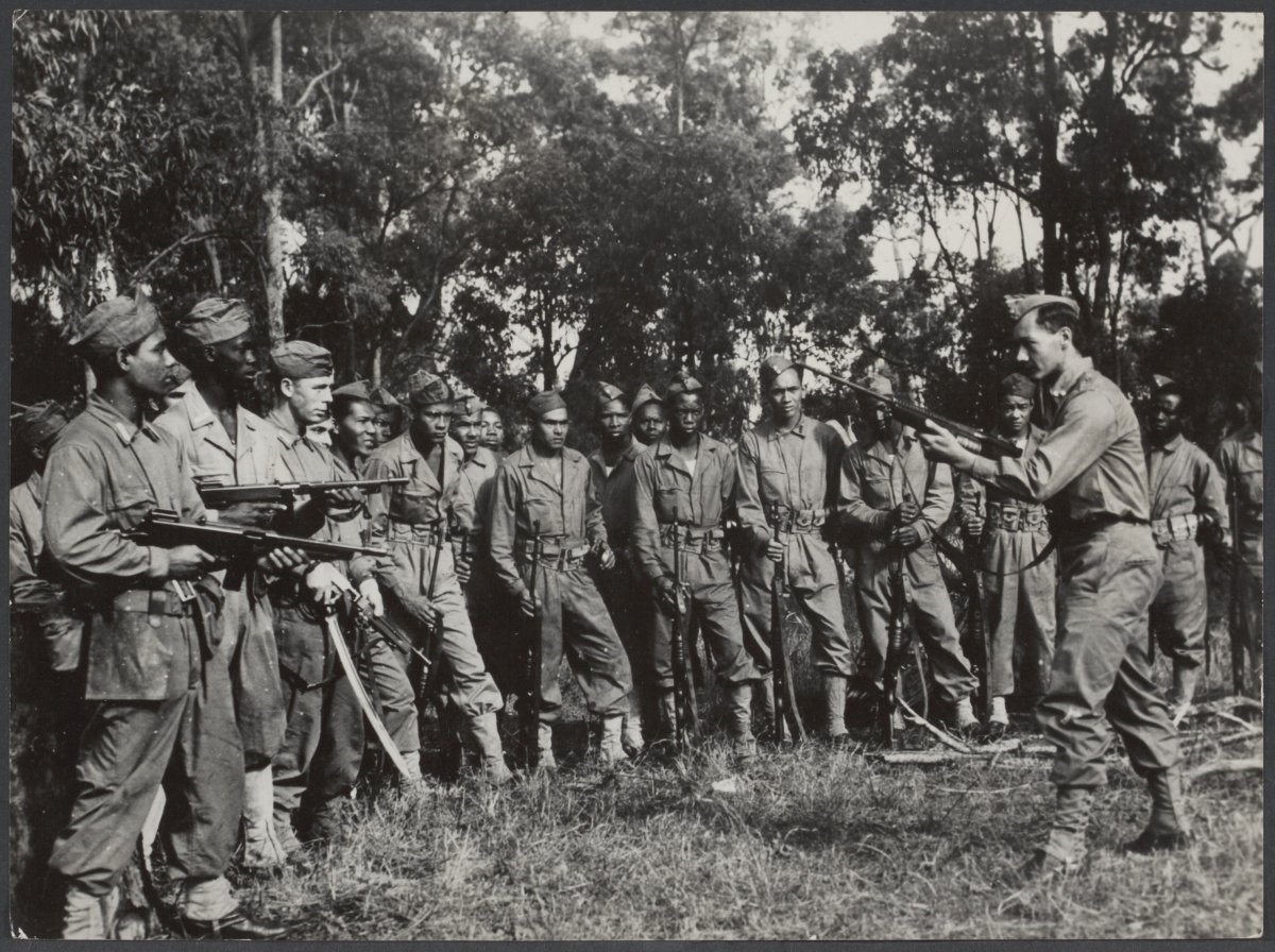 Soldiers of the Royal Netherlands East Indies Army in July 1945. The soldier on the right carries a Johnson rifle.
