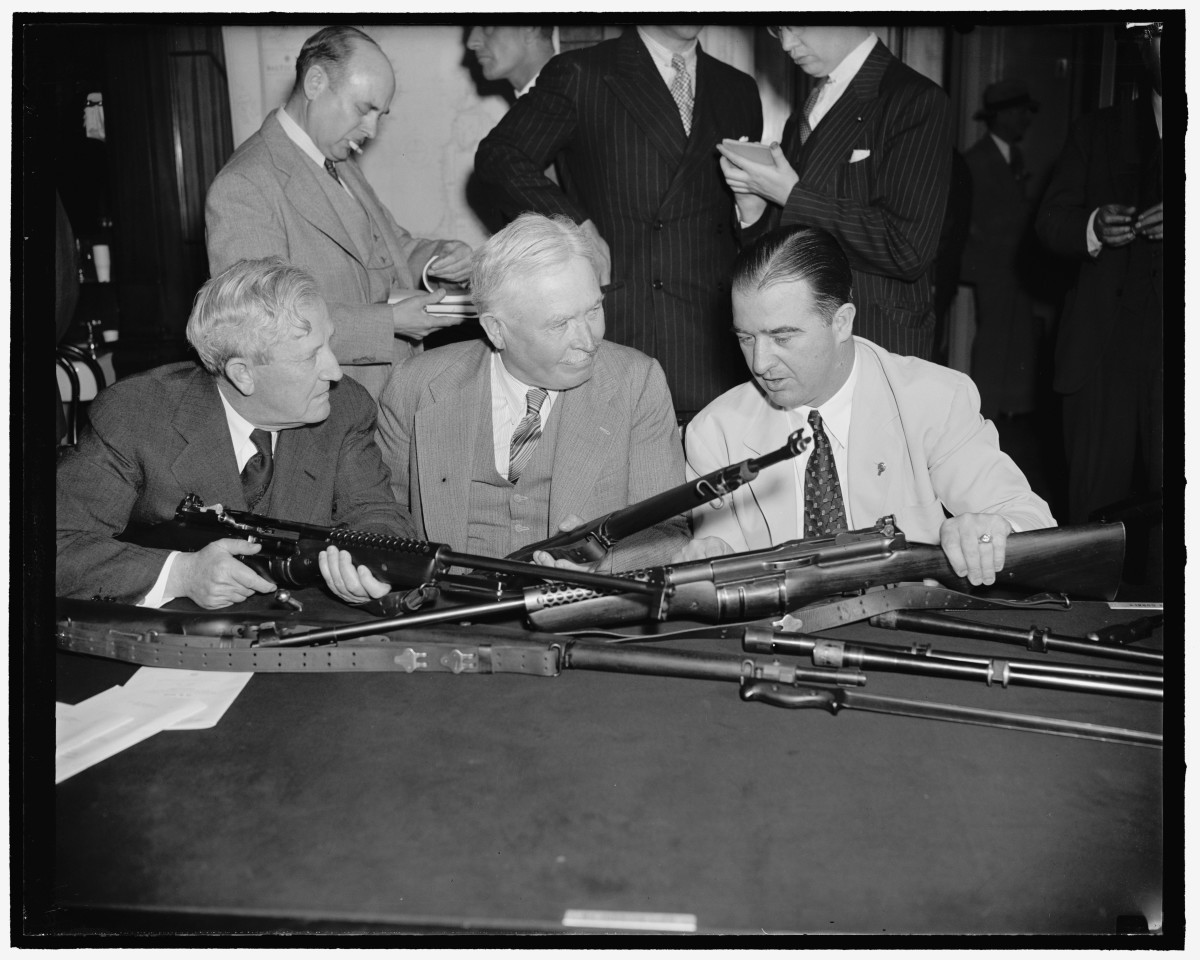 Senator Morris Sheppard, left, Chairman of the Senate Military Affairs Committee, Maj. Gen. George A. Lynch, U.S. Chief of Infantry, and Senator A.B. Chandler of Kentucky, inspect the Johnson semi-automatic rifle which may replace the Garand gas-operated rifle as the Army's standard shoulder weapon.