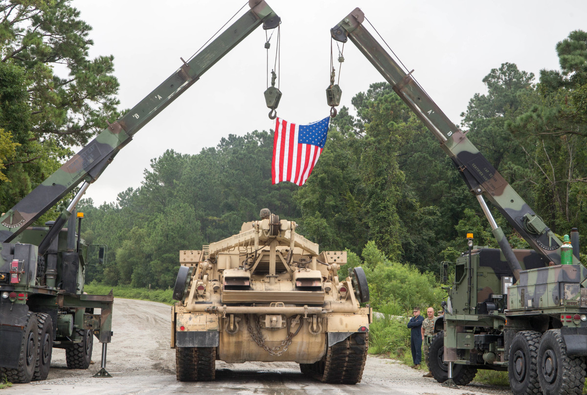 A U.S. Marine with 2d Tank Battalion, 2d Marine Division, drives one of the last commissioned Hercules M88 recovery vehicles off a maintenance lot on Camp Lejeune, North Carolina, August 17, 2020. As part of Force Design 2030, Hercules M88 recovery vehicles are being diverted from the Marine Corps in an effort to modernize and realign capabilities, units and personnel to higher priority areas.