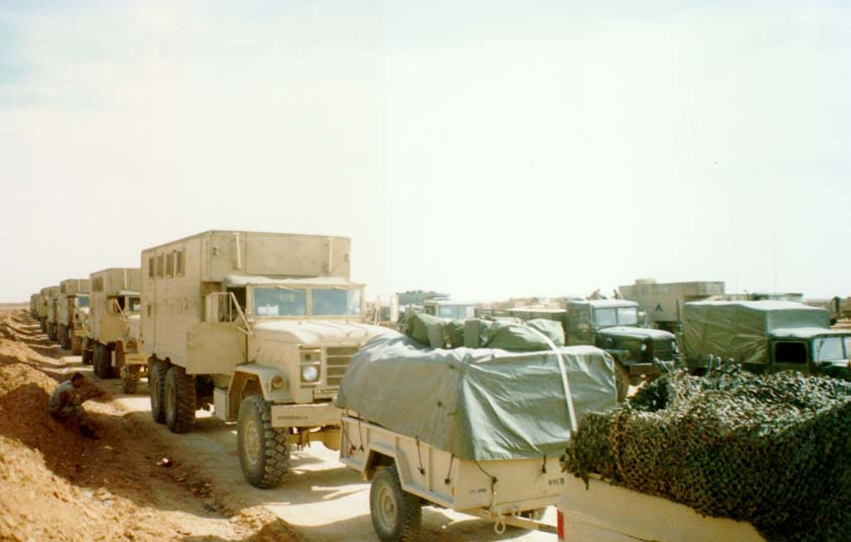 XVIII Airborne Corps Main Command Post convoy shows a mixture of vehicle colors.