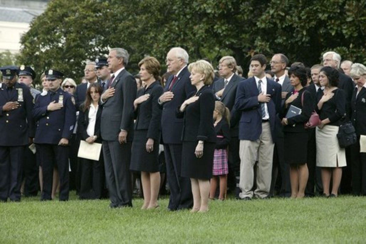 President George W. Bush and Vice President Dick Cheney on September 11, 2004, lead a moment of silence on the South Lawn with White House staff and families of victims of 9/11.