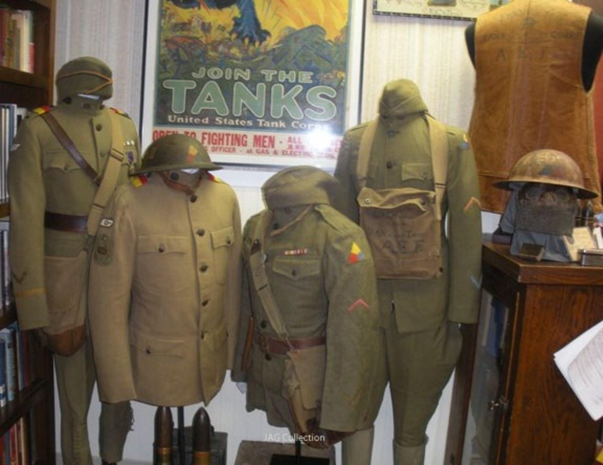 Display of Tank Corps uniforms, helmets, and headgear.