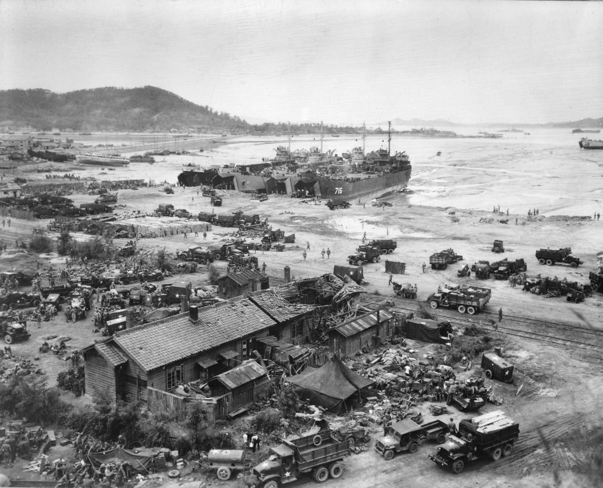 Four tank landing ships unload men and equipment on Red Beach one day after the amphibious landings on Inchon.