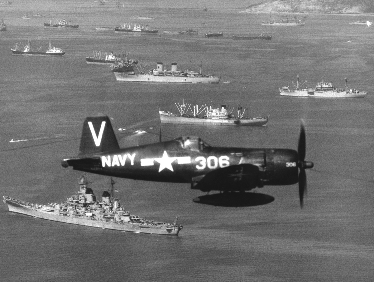 "A Vought F4U-4B Corsair of Fighter Squadron 113 (VF-113) (the ""Stingers"") flies over UN ships off Inchon, Korea, on 15 September 1950. VF-113 was assigned to Carrier Air Group Eleven (CVG-11) aboard the aircraft carrier USS Philippine Sea. The battleship USS Missouri is visible below the Corsair."