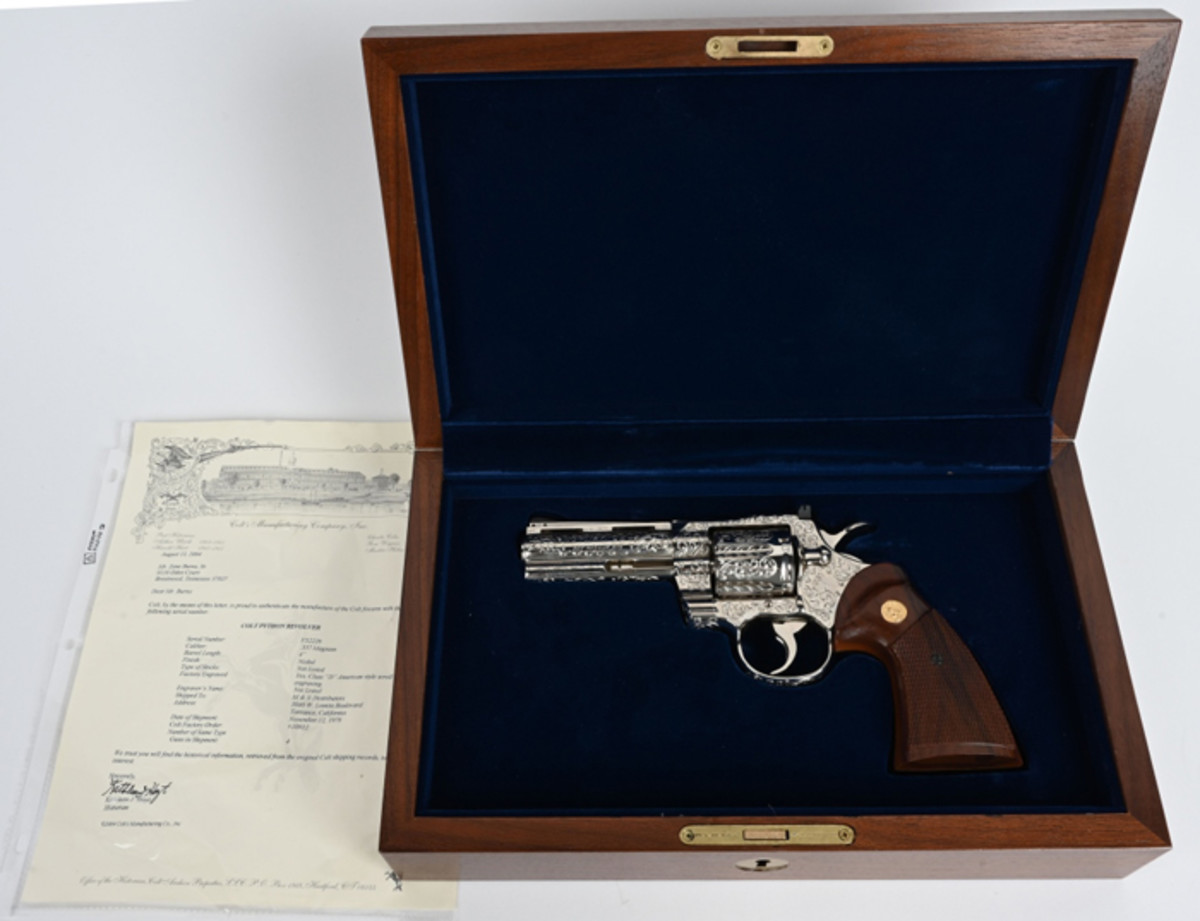 Cased, factory engraved Colt 4in nickel Python .357 Magnum in like-new, unfired condition in walnut Colt display case. Factory letter states gun was shipped to buyer in 1979.