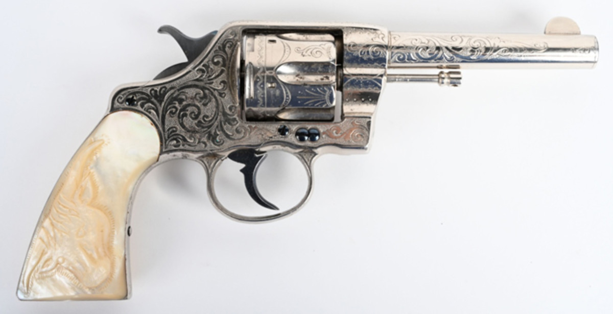 Antique Cuno Helfricht-engraved Colt Navy .41-caliber revolver, pearl stocks with carved steer head. Shipped in 1897.