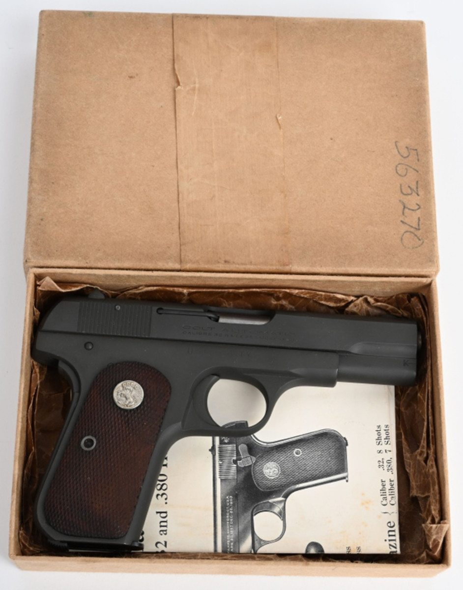 Antique US Colt Model 1903, .32-acp Pocket Hammerless 'U.S. Property' pistol, commonly known as the General Officers Model. Manufactured in 1942. Retains original box.