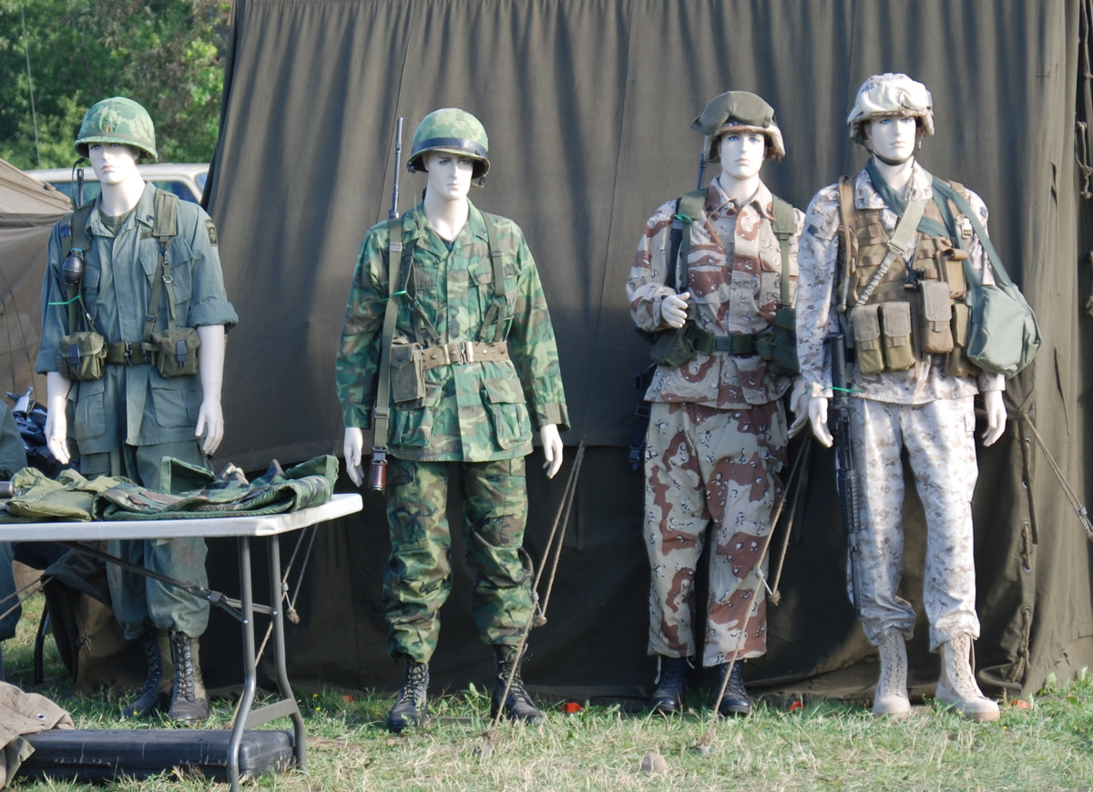 Collection of four mannequins in progressive US military attire.