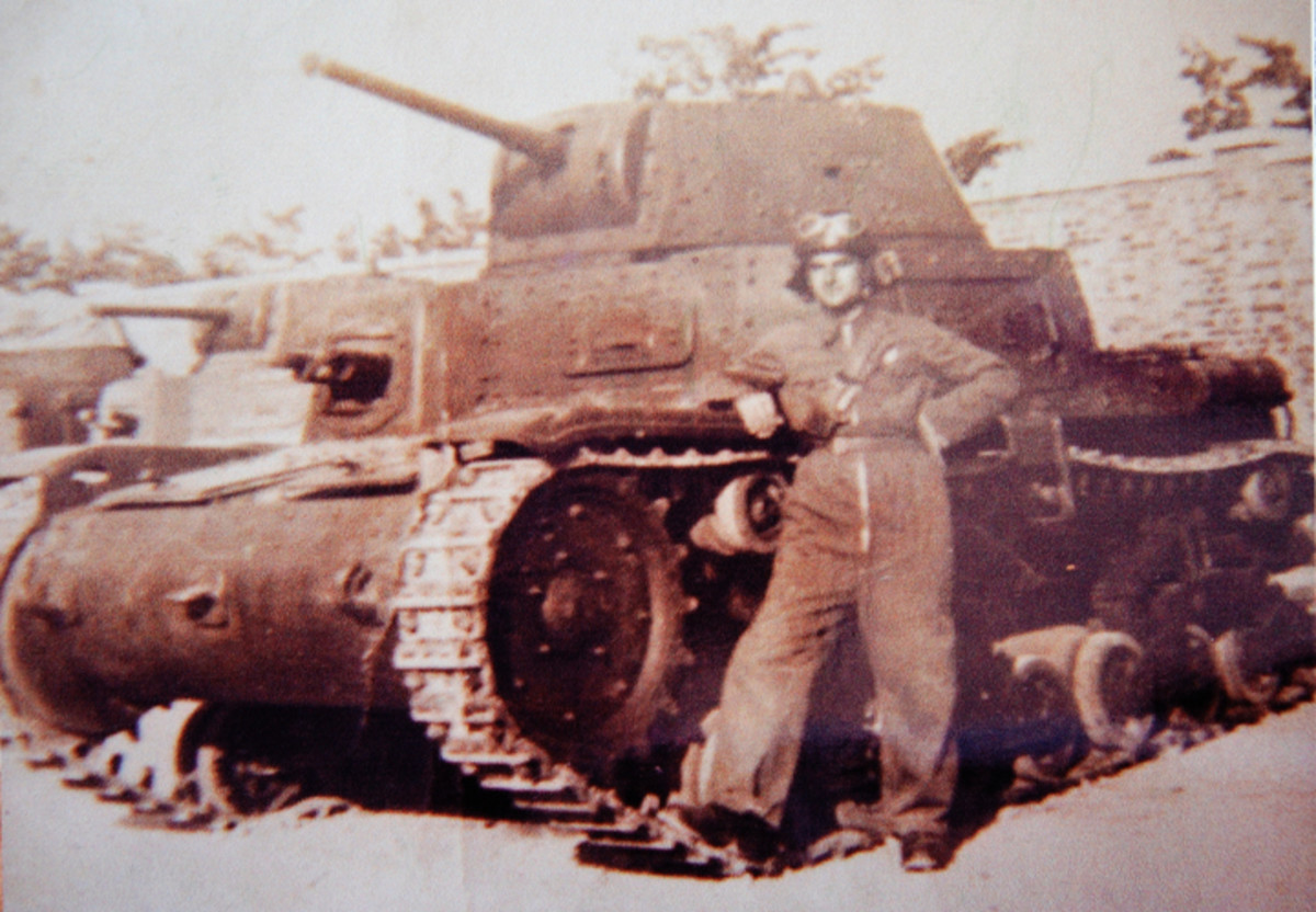 Tank driver Corporal Lorenzo N— with his M13/40 tank. He fought in North Africa with the Ariete Armored Division, surrendered on Cap Bon and ended the war in the New Orleans Italian POW camp.
