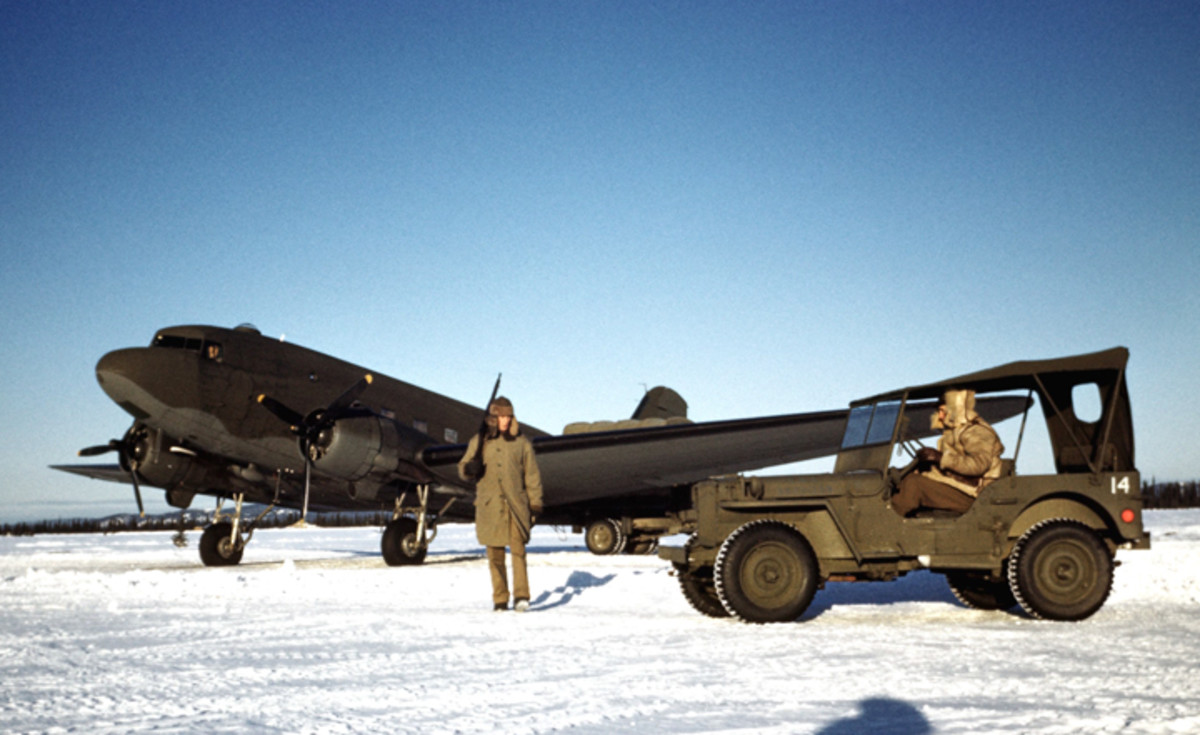 GOOSE BAY, LABRADOR - DECEMBER 1942: An soldier guards a C-47 Skytrain at a United States Army Air Force base in December 1942 in Goose Bay, Labrador, Canada.