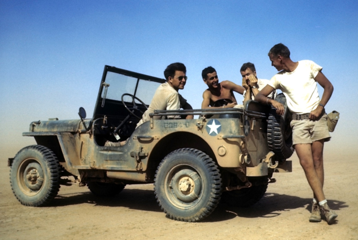 BENGHAZI, LIBYA - AUGUST 11,1943:  Members of the 376th Bombardment Group talk in a jeep at the U.S Air Force Base in Benghazi, Libya. (Photo by Ivan Dmitri/Michael Ochs Archives/Getty Images)