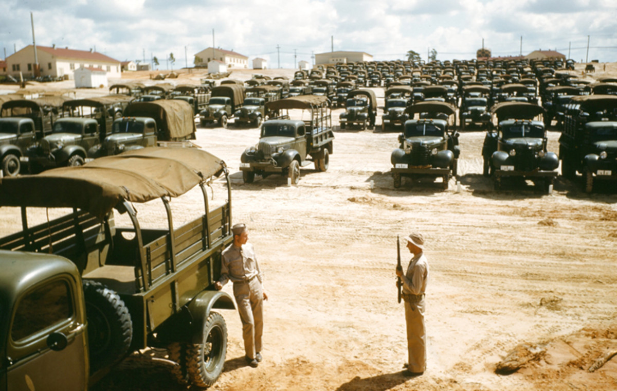 FAYETTEVILLE, NC - 1942: A view of army soldiers on guard duty at Fort Brag in Fayetteville, North Carolina in 1942 with pre-war 1-1/2 ton trucks.