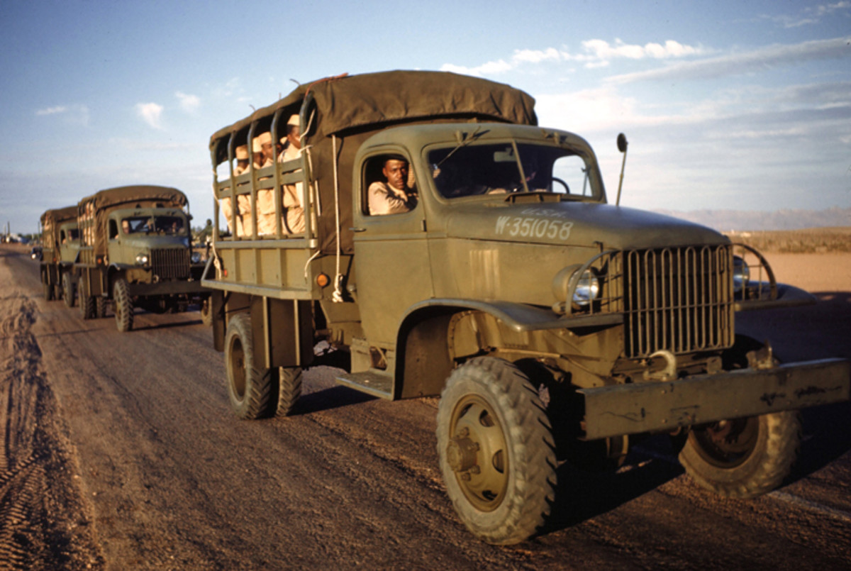 LAS VEGAS, NEVADA - CIRCA 1942: A view African American Army soldiers ride in an Army G-506 truck (registration no. W-351058) at the Las Vegas Army Air Force Airfield in Las Vegas, Nevada. Circa 1942.