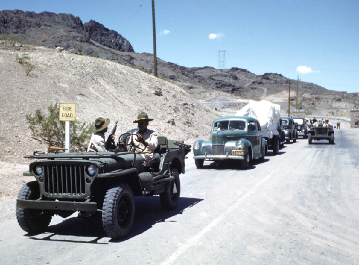 LAS VEGAS, NEVADA - CIRCA 1942: A view as two African American Army soldiers drive a jeep at the Las Vegas Army Air Force Airfield in Las Vegas, Nevada. Circa 1942.