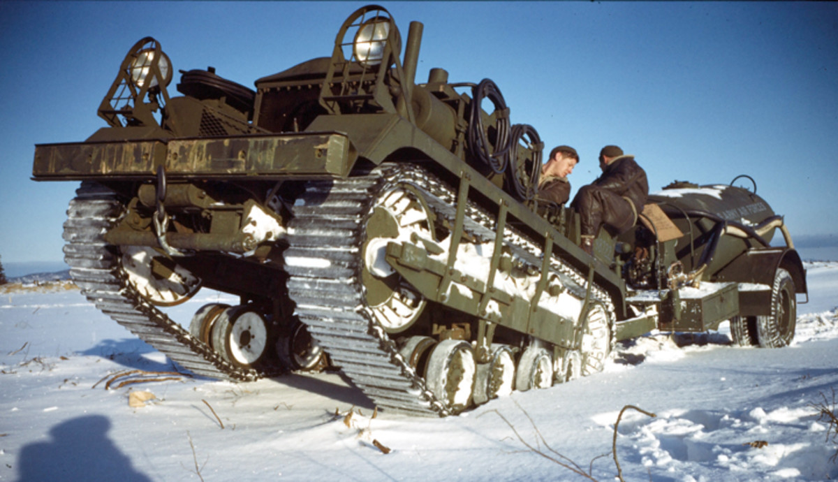 GOOSE BAY, LABRADOR,CANADA- DECEMBER 1942: U.S Airmen pull a fuel trailer with an M2 High Speed Tractor on the U.S. Air Base in Goose Bay,Labrador, Newfoundland,Canada.