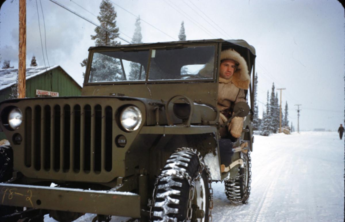 GOOSE BAY, LABRADOR,CANADA- DECEMBER 1942: A U.S Airmen drives a jeep on the U.S. Air Base in Goose Bay,Labrador, Newfoundland,Canada.