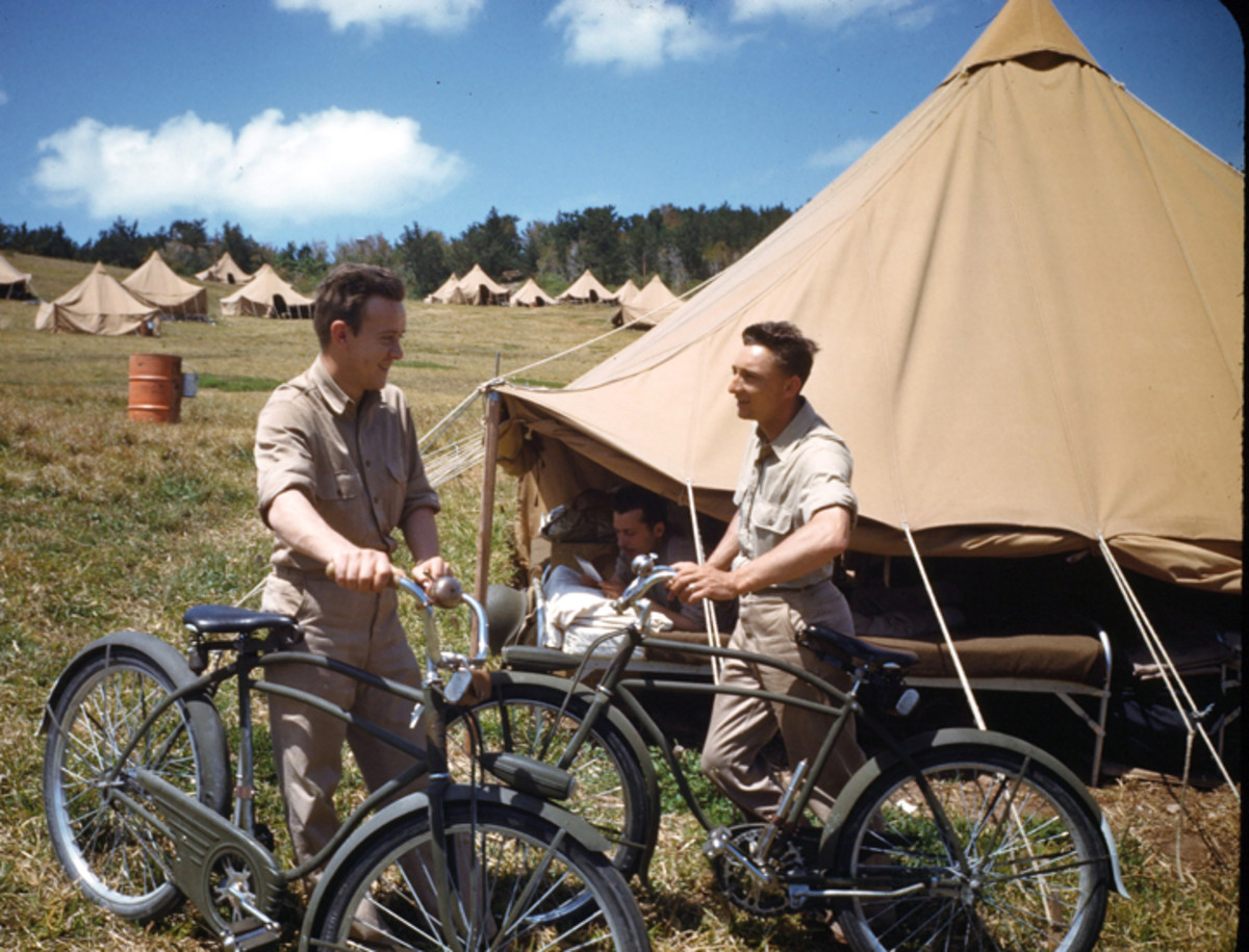 BERMUDA - CIRCA 1943: U.S. Marines ride OD-painted bicycles after pitching tents in a field at the U.S. Navel Air Base in Bermuda.