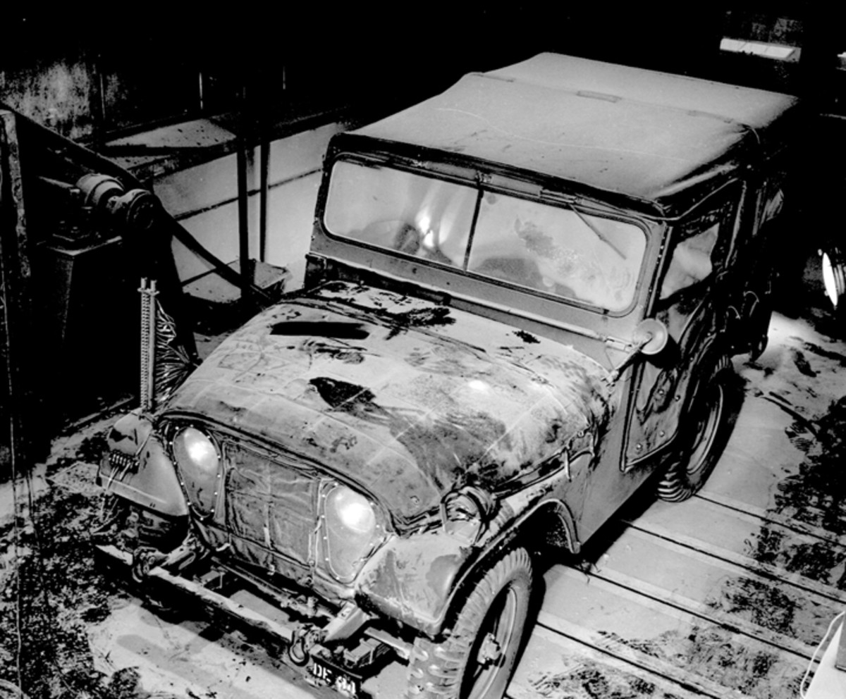 In July 1954, this M38A1 was placed in Detroit Arsenal's cold room for testing of dual purpose heater kits. Note the insulation blanket covering the hood, and the winter front sealing the grille.