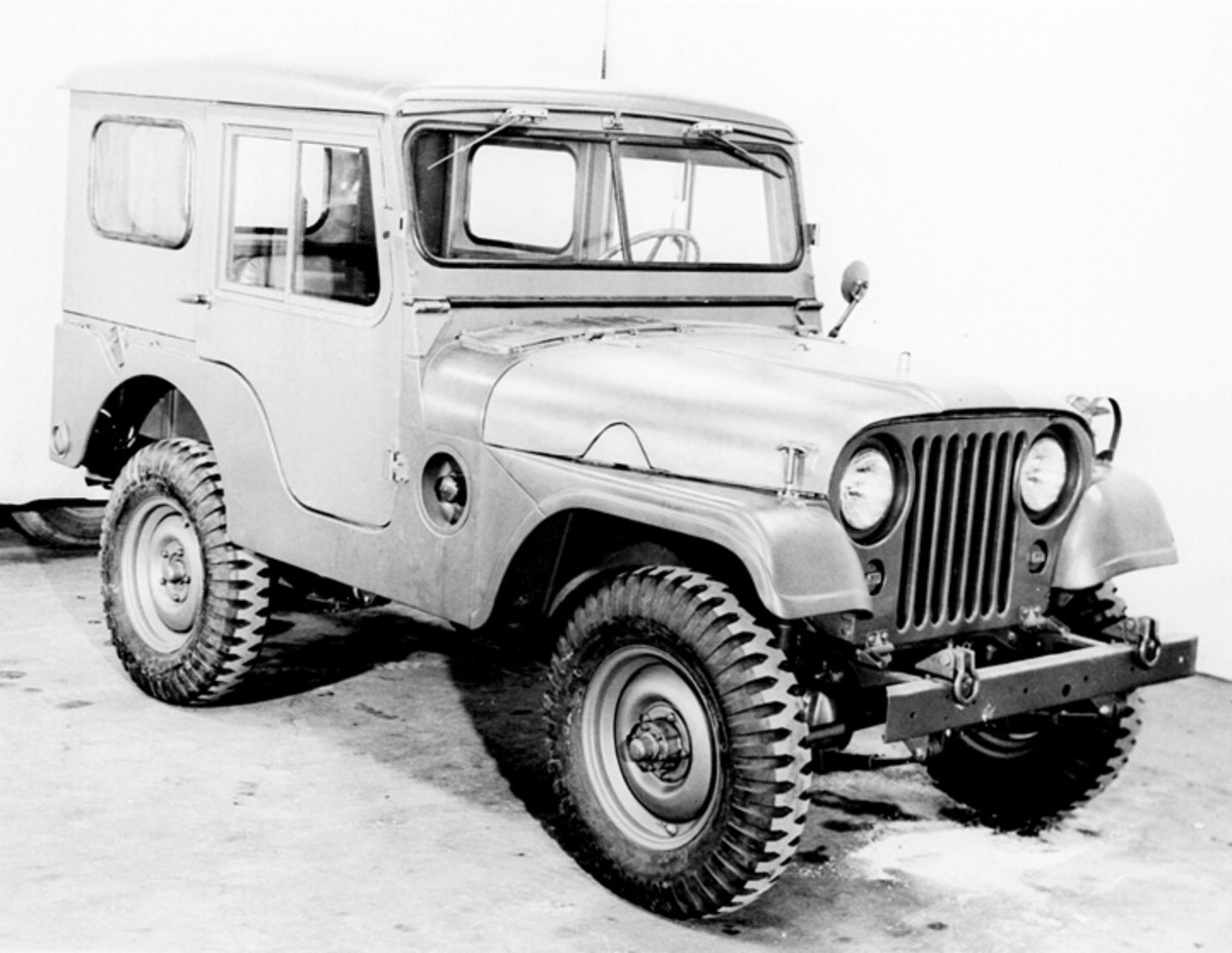 Better suited for a cold environment was this vehicle with slave receptacle and hard top enclosure, photographed in April 1953. Faintly visible in this photo are the four straps securing the battery box cover on early M38A1 vehicles.