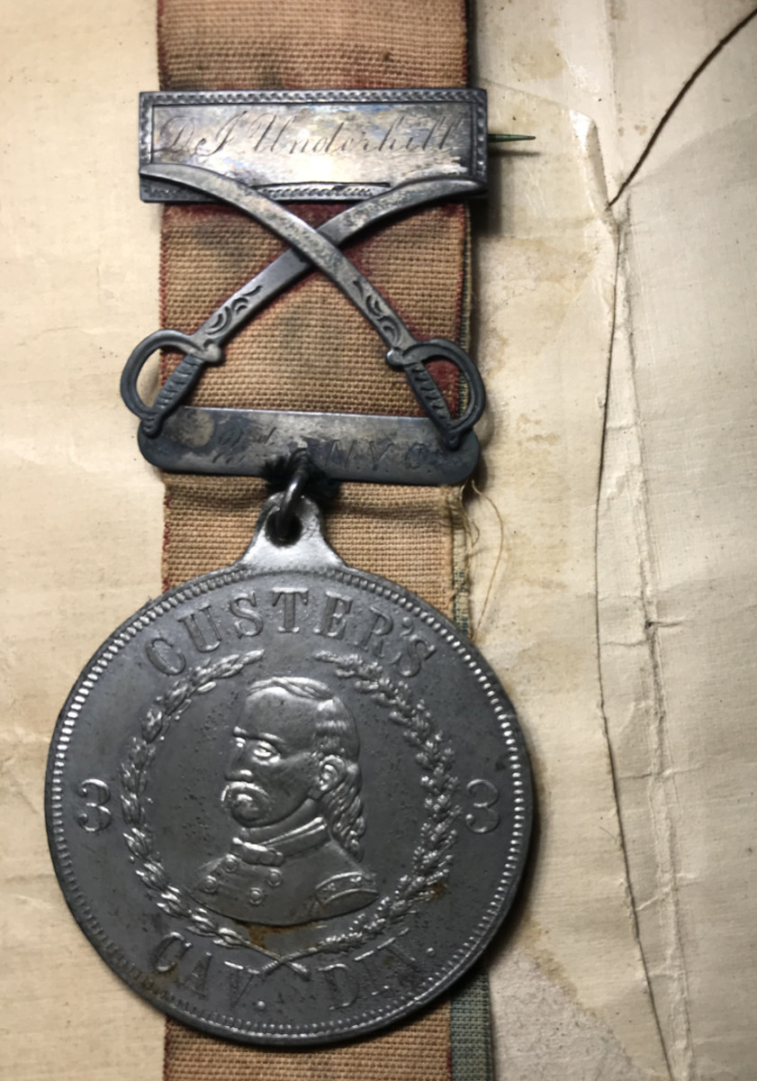 "Not a federally issued medal but rather a privately purchased campaign or unit badge (sometimes referred to as ""Custer's Divisional Badge""). Dan Underhill, a cavalry soldier serving under George Armstrong Custer most likely purchased it in June 1865 according to the original documents that accompanies it."