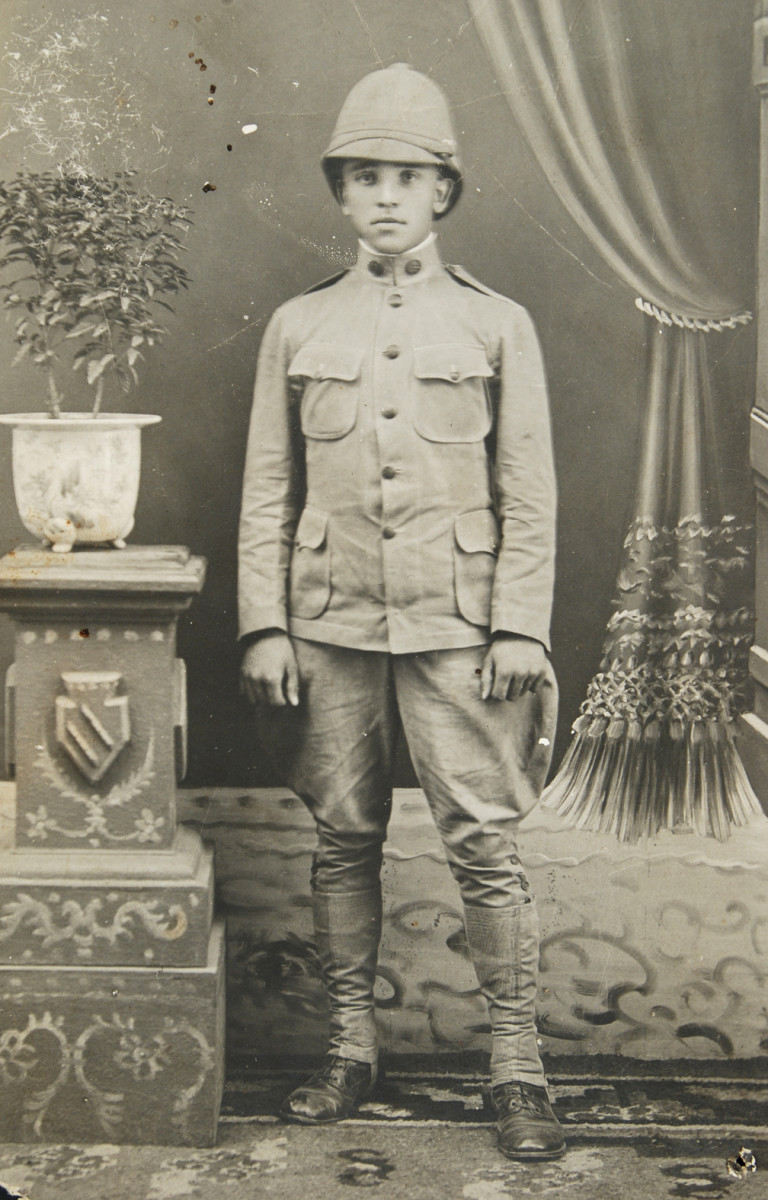 US soldier wearing 1902 pattern uniform with a summer helmet.