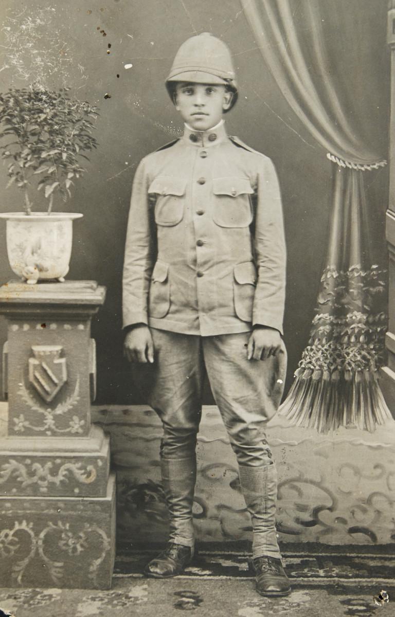 US soldier wearing 1902 pattern uniform with a summer helmet.