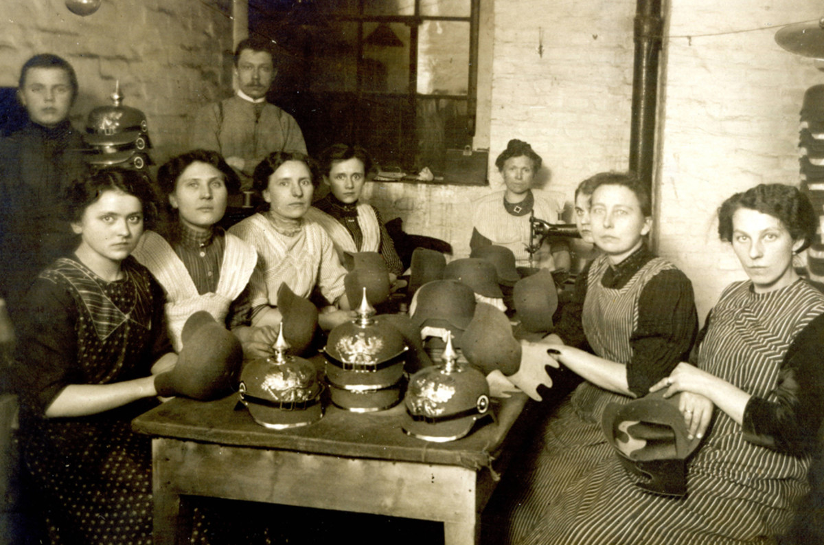 Laborers assembling German felt helmets, ca. 1915
