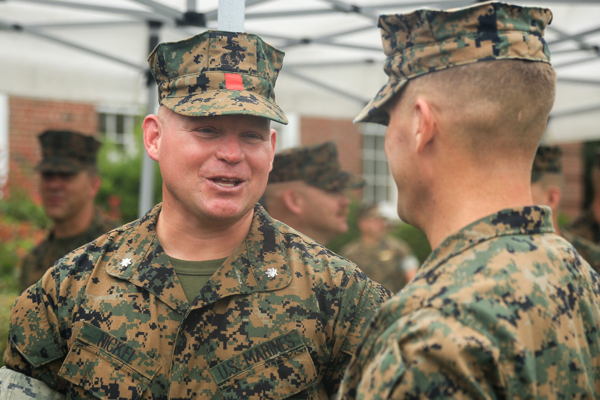 U.S. Marine Corps Maj. Patrick J. Foehl, the ceremony commander of troops, 2nd Landing Support Battalion, takes part in the invocation during a re-activation ceremony at Camp Lejeune, North Carolina, Oct. 16, 2020. The battalion was re-activated again to support aerial delivery and beach landing operations in support of tactical logistics missions for 2nd Marine Logistics Group (MLG) and II Marine Expeditionary Force. In line with the commandant's planning guidance, MLGs across the Marine Corps re-activated their landing support battalions after a 40-year hiatus.(U.S. Marine Corps