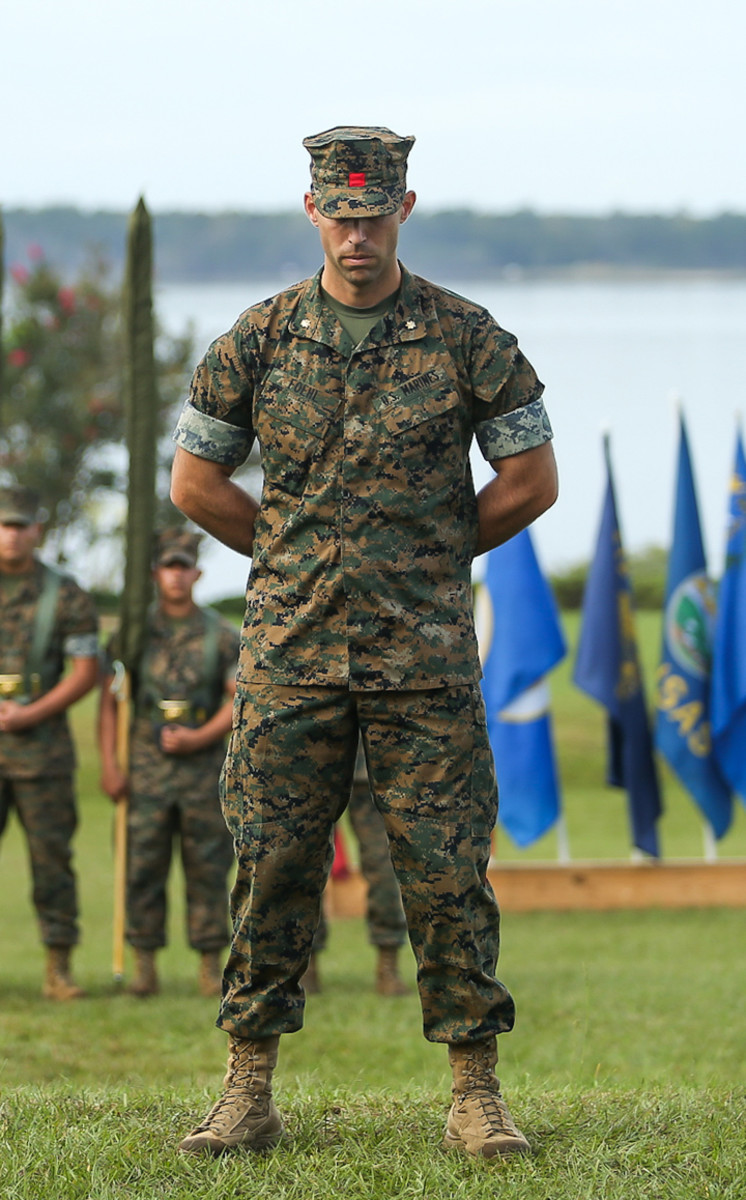 U.S. Marine Corps Maj. Patrick J. Foehl, the ceremony commander of troops, 2nd Landing Support Battalion, takes part in the invocation during a re-activation ceremony at Camp Lejeune, North Carolina, Oct. 16, 2020. He is wearing the distinctive red patch on his cover.