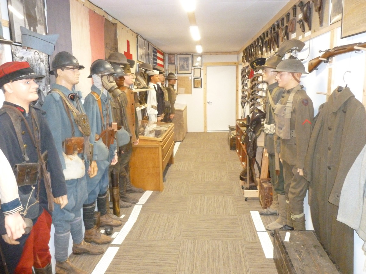 The uniforms are mounted on custom-made mannequins built to be the correct size for each uniform. Some of the heads are detailed from photos of the person who wore the uniform.