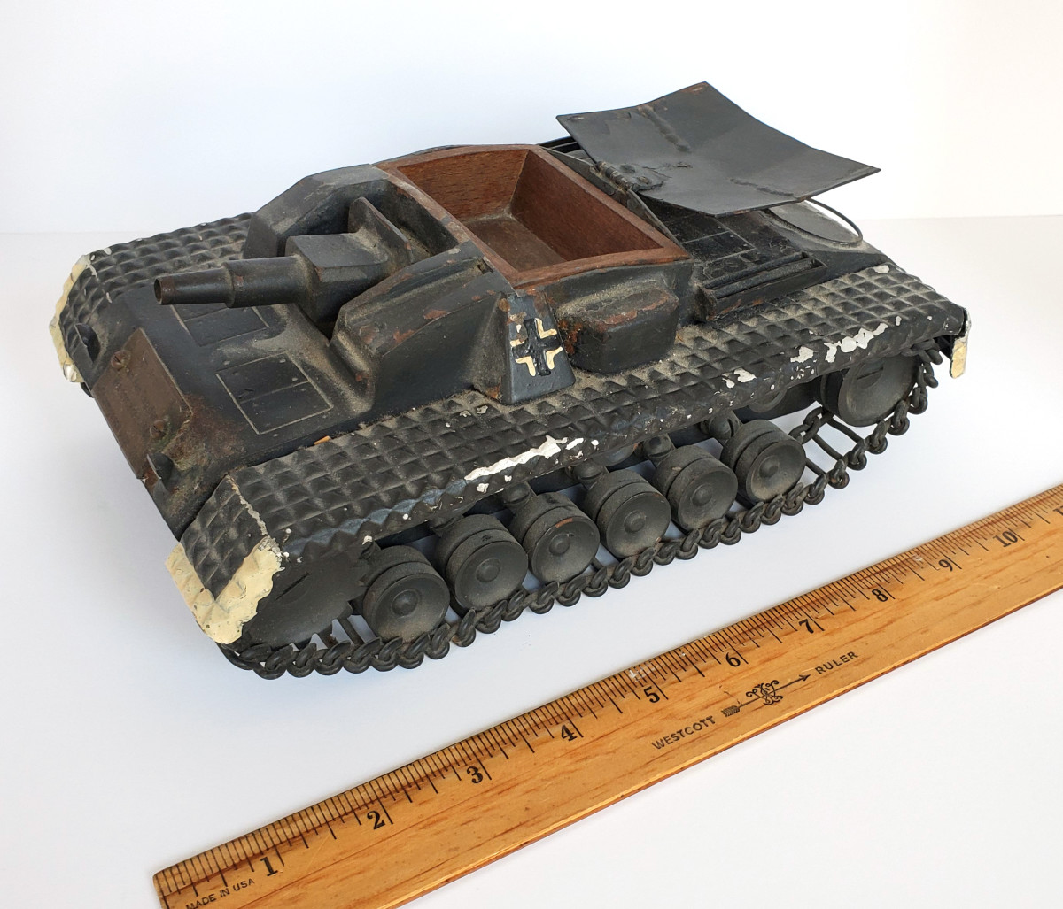 """The model of the assault gun measures about 10"""" x 7"""" x 4"""". The German recognition flag tilts up to reveal a small compartment large enough to hold cigarettes."""