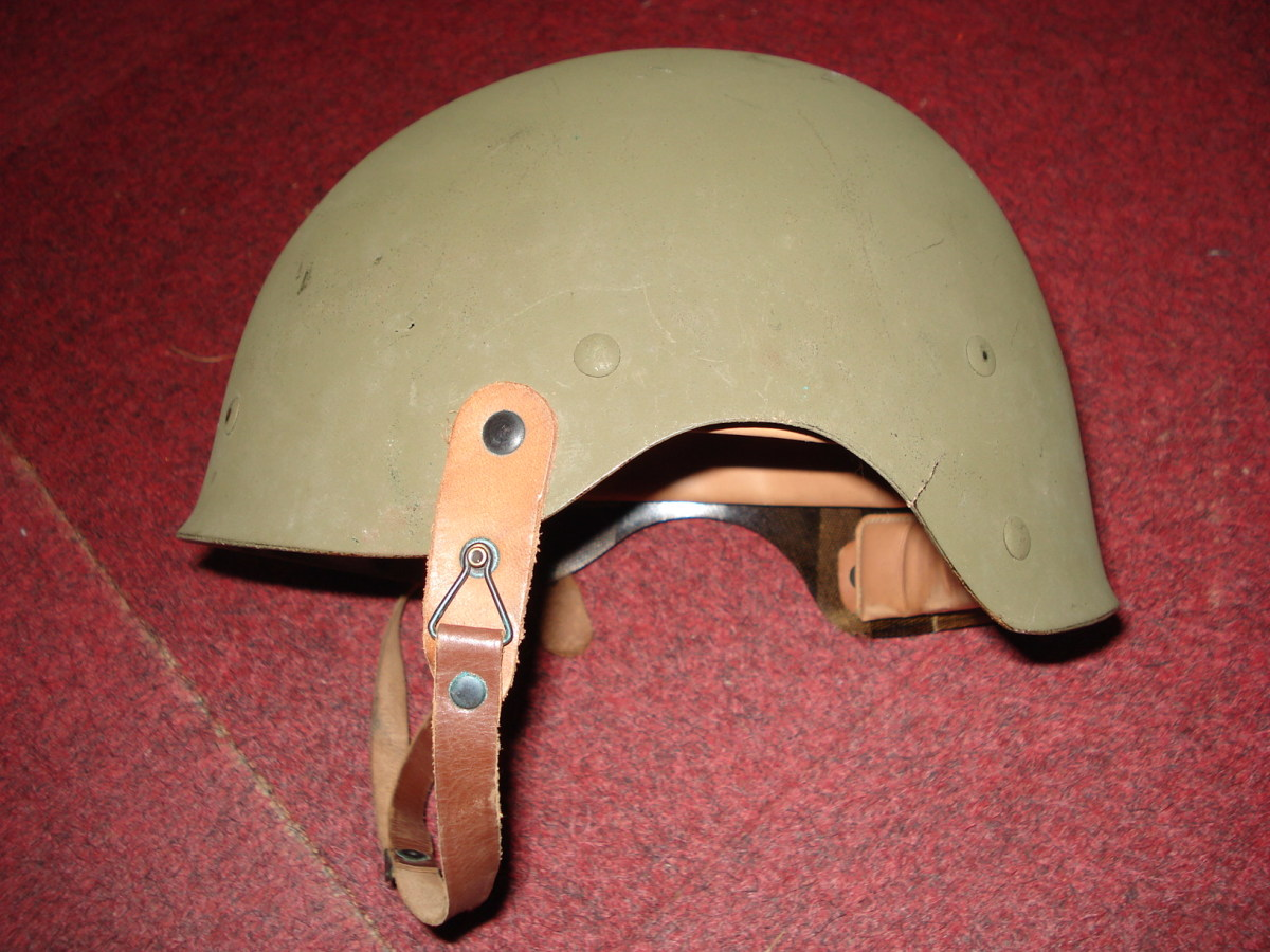 The 'Liner, helmet, M-1, Crash' was designed by the U.S. Army Quartermaster Corps in 1944 as part of an ongoing project to equip armored vehicle crews with a helmet that would provide ballistic as well as bump protection. Several designs based on the M-1 infantry helmet were tested but none were accepted for use prior to the end of the war except the 'Liner, Helmet, M-1, Crash'.