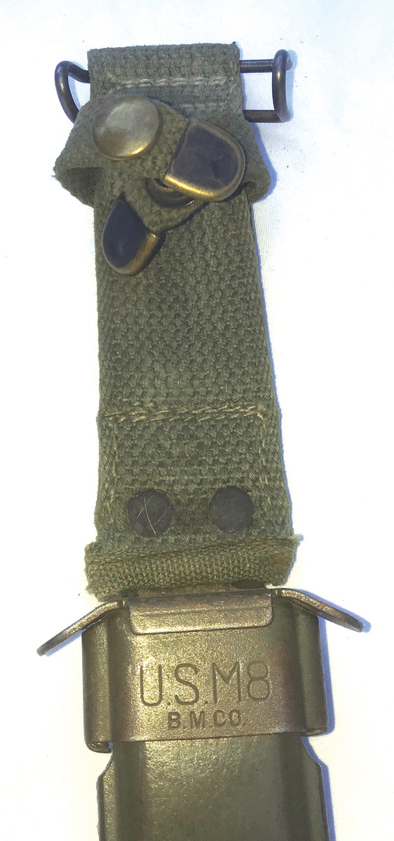 This is the left-over-right snap arrangement as found on later M8A1 scabbards.