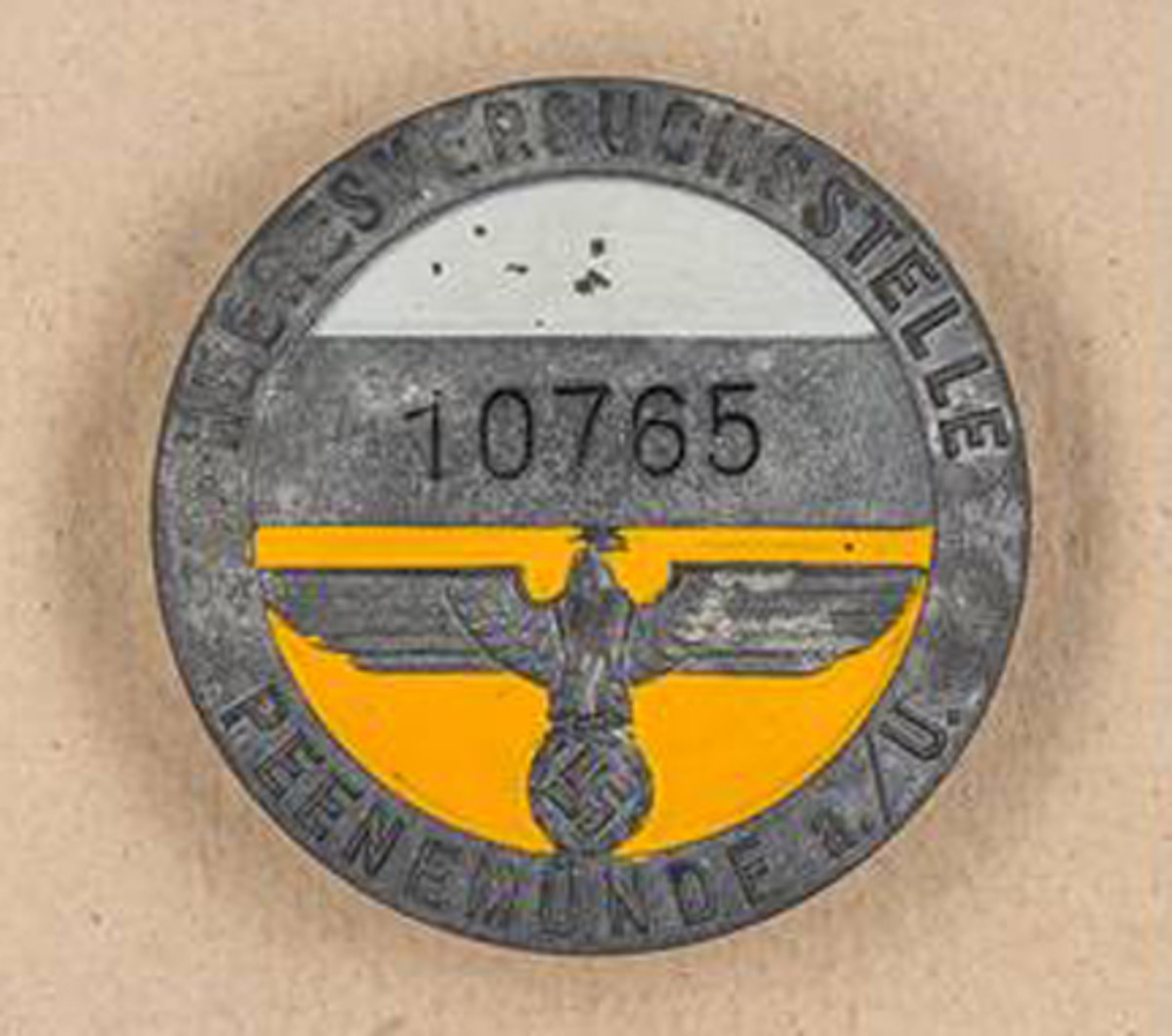 This original badge sold for an undisclosed amount in 2015.
