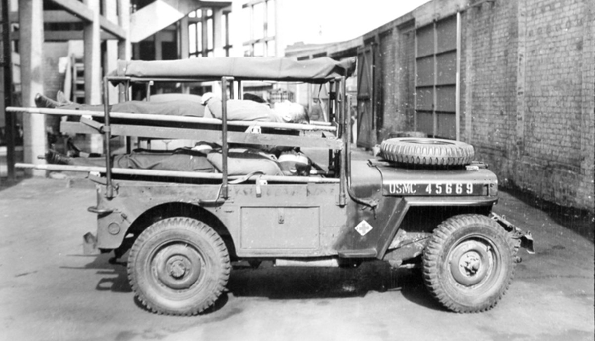 """A quick identifier of the 200 vehicles known as the """"Holden Jeep"""" is the large medical equipment storage locker in the position normally occupied by a passenger's seat."""