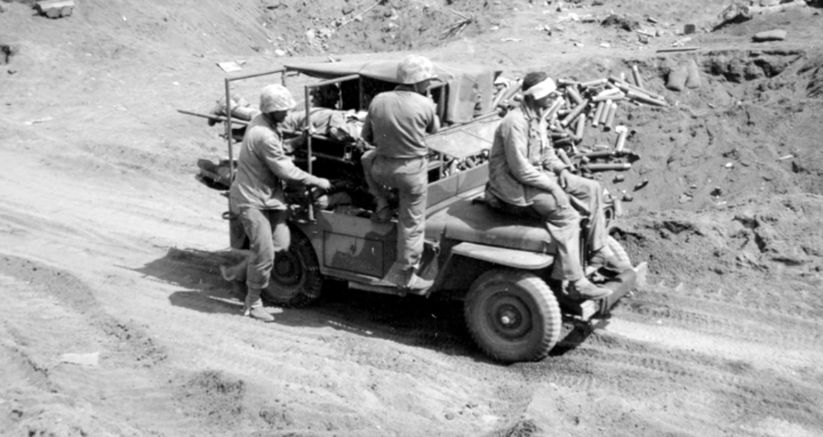 Another photo from Iwo Jima, this time showing casualties being transported. Note the camouflage paint scheme. The Holden conversions and their crews performed admirably on Bougainville, Saipan, Iwo Jima, Okinawa, and were employed again in the Korean War.