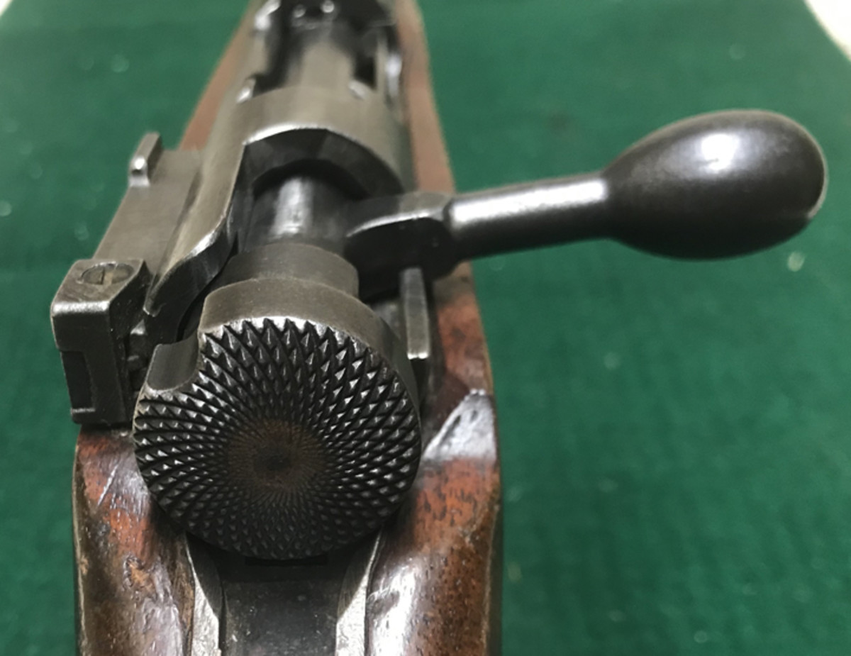 The safety knob is a finely knurled example typical of early Type 99s. As the war progressed this would be simplified to first a series of vertical groves, and then later, to a flat piece of metal. The straight bolt handle is typical of the Type 99.