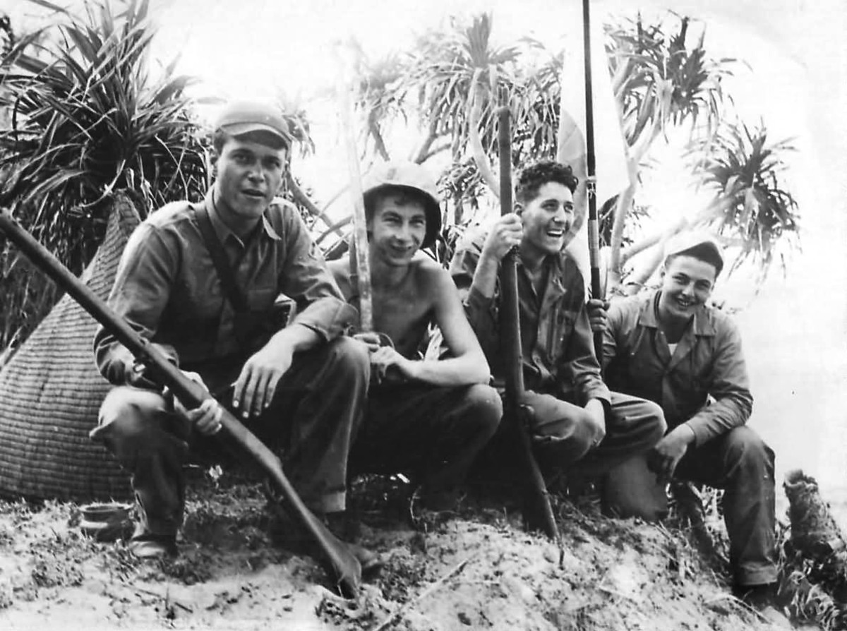 WWII photo of US soldiers with souvenir Type 99 rifles.