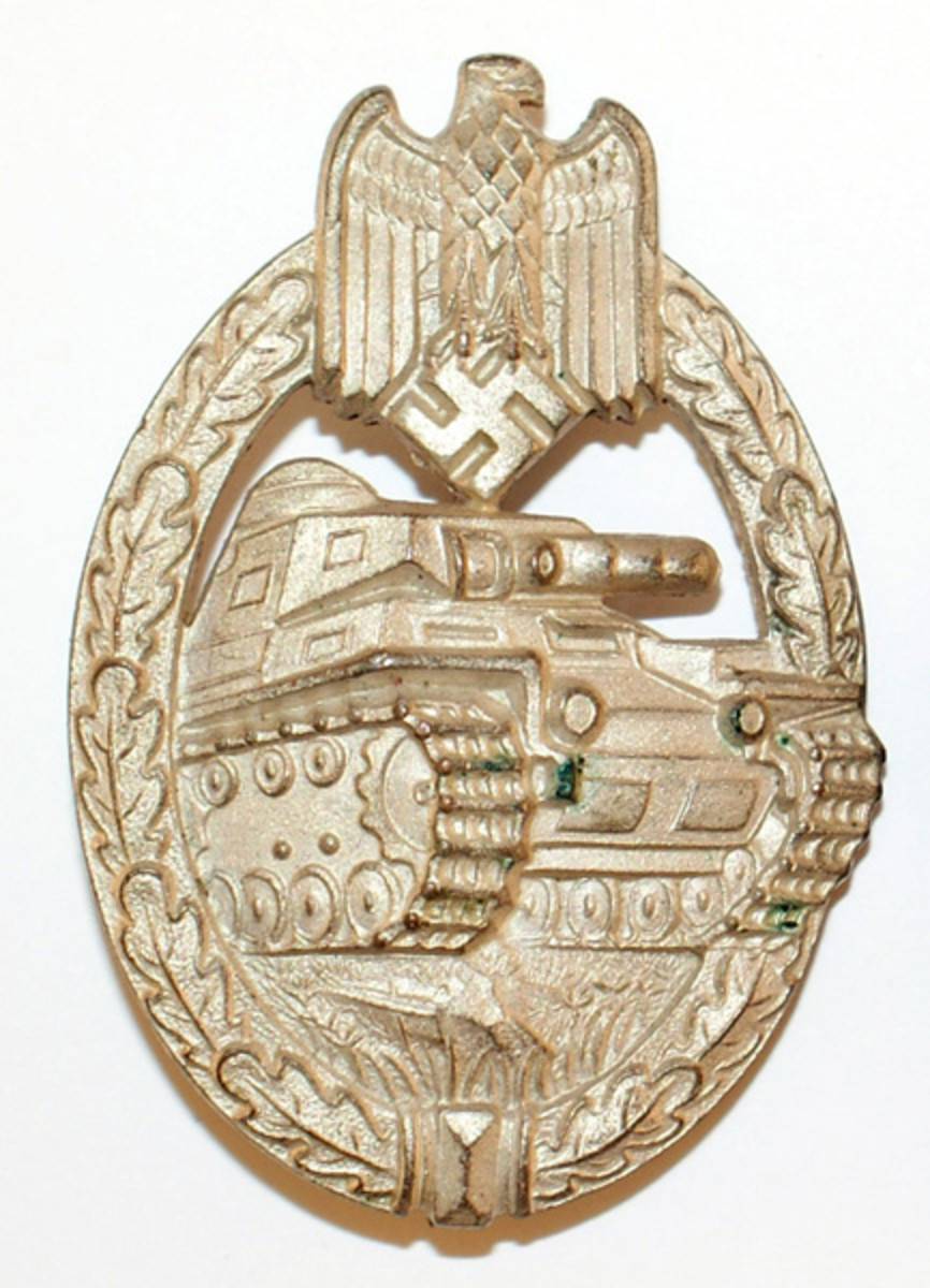 The Panzerkampfabzeichen in silver was one of the earliest war badges to be instituted by the Germans. It's difficult to determine how many were issued during the war, but the new collector can still find examples readily available. Note the traditional oak leaf design wreath common in many German combat badges.
