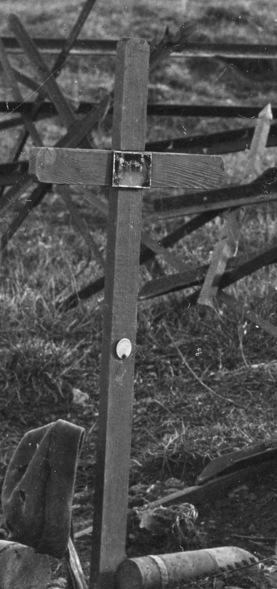 """High resolution magnification revealed a name plate and identification disc (""""dog tag"""") nailed to the cross. There was a name scratched on to the plate, but not totally legible on the photograph: """"Eugene something."""" The Model 1917 dog tag, however, was unreadable."""