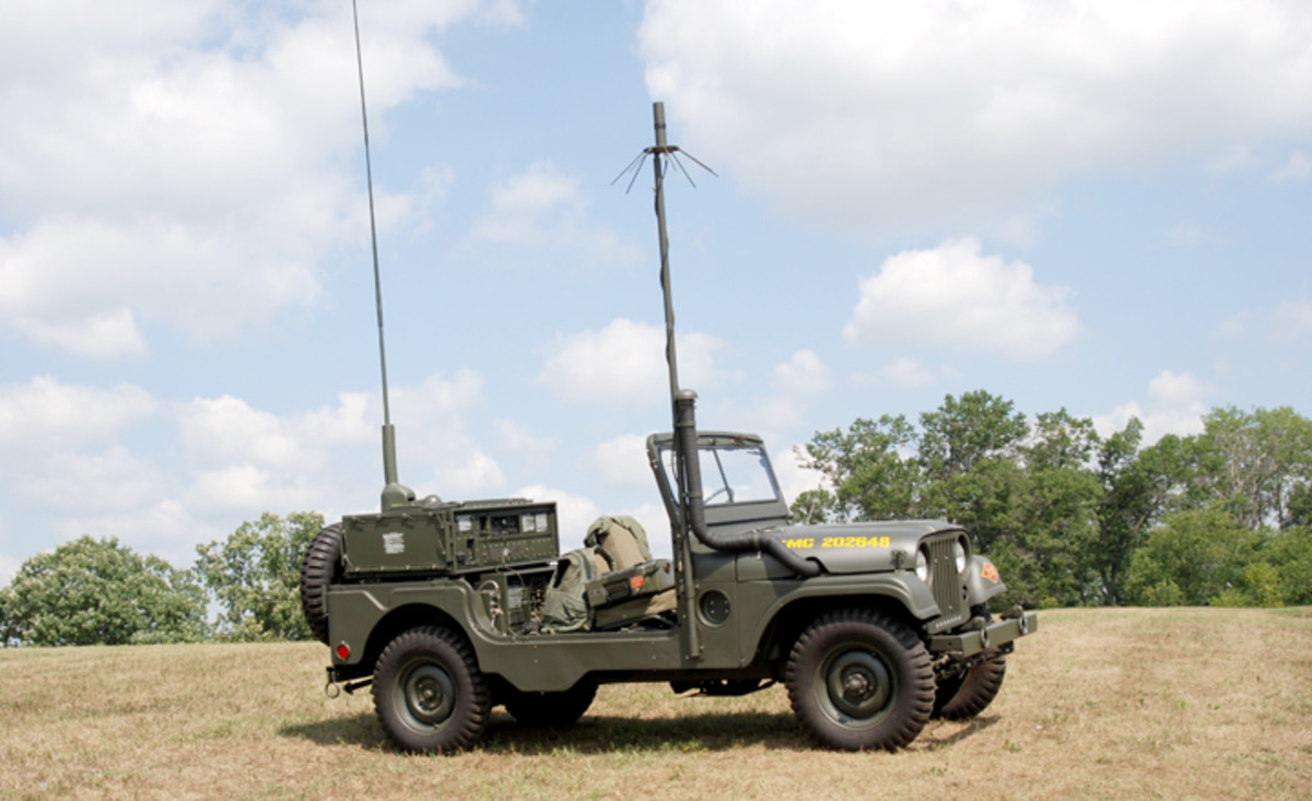 MRC-87 USMC Forward Air Control Jeep. The different pieces of communications equipment required individual antennas. The ARC-55 utilized the antenna mounted on the Jeep's right side and the AN/TRC-75 used the one on the left.