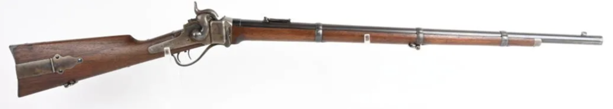 Outstanding Berdan Sharps Model 1859 rifle, bore .52, one of the finest-condition rifles known of the approximately 2,000 shipped to Berdan in 1862. Extraordinary condition, all original in original Civil War-era rifle case, ID'd to James Baker of Ohio, who enlisted with the legendary Berdan Sharpshooters, 1st Regiment, Company K, at age 20.
